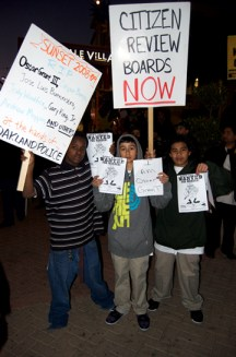"These children, a racial cross-section of Oakland, seem determined to stop the police' open season on young men of color before it's their turn. The sign on the left reads, ""Sunset 2008-90 RIP Oscar Grant III, Casper Banjo, Jose Luis Buenrostro, Jody Woodfox, Gary King Jr., Andrew Moppin and others at the hands of Oakland police."" – Photo: Demondre Ward"