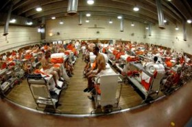 "The judges observed in their ruling that overcrowding, such as ""the use of triple bunks in gymnasiums … ha[s] 'substantially increased the risk of the transmission of infectious illnesses among inmates and prison staff,'"" quoting a California appellate court. This is the California Institute for Men in Chino. – Photo: AP"