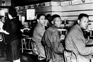 In another historic use of the sit-down strike, this one to enforce civil rights rather than labor rights, three North Carolina A&T college students – Ronald Martin, Robert Patterson and Mark Martin – sat down to integrate this Greensboro, N.C., Woolworth lunch counter on Feb. 2, 1960. As these sit-downs spread throughout the South, they became known as sit-ins. – Photo: UPI