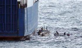 "Somali pirates – fishermen who have been forced out of their fishing grounds by foreigners – hijack the MV Faina on Sept. 24 in Somali waters. A Ukrainian cargo ship loaded with heavy weaponry, including 33 Russian-designed T-72 battle tanks, the Faina is still being held, for $35 million ransom, 89 days later. Newsweek quotes a leader of the pirates, interviewed by phone from the bridge of the Faina, who explains, ""If we are forced to avoid fishing our waters, then those [commercial] ships are all our fish."""