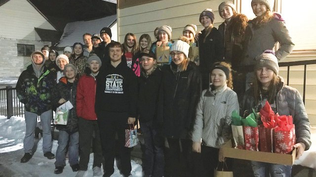Youth deliver fruit baskets to area families