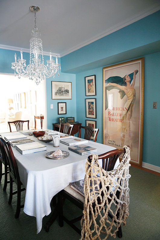 blue dining room with crystal chandelier and art prints / sfgirlbybay