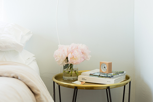 pink flowers on gold bedside table / sfgirlbybay