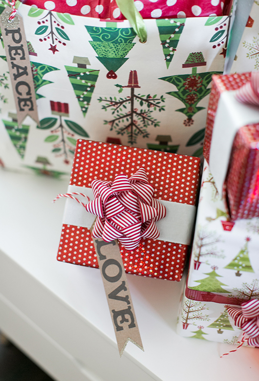 green and red christmas wrapping paper, bows and personalized name tags / sfgirlbybay