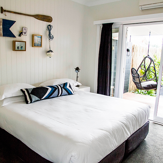 guest room with terrace swing at the albatross inn / sfgirlbybay