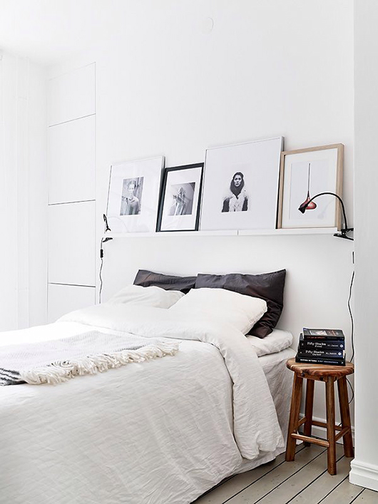 simple black and white bedroom with wood stool nightstand / sfgirlbybay