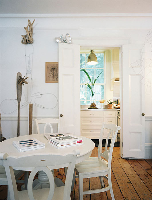 modern white dining table and chairs with wood floors / sfgirlbybay