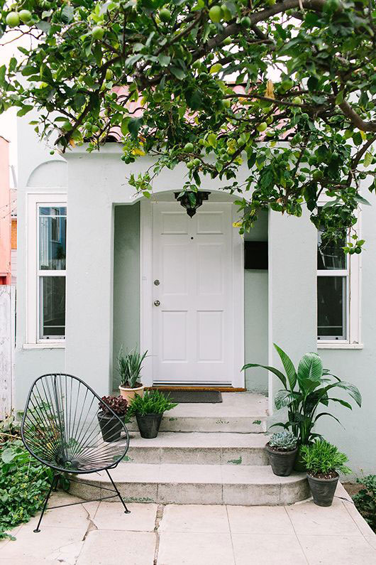 pale gray exterior paint with white door and greenery / sfgirlbybay