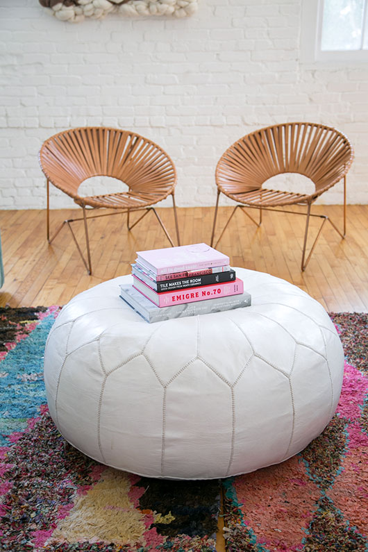 leather aldama chairs from the citizenry and maven collection leather pouf / sfgirlbybay