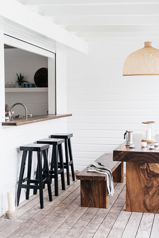 black barstools and wood dining table and benches / sfgirlbybay