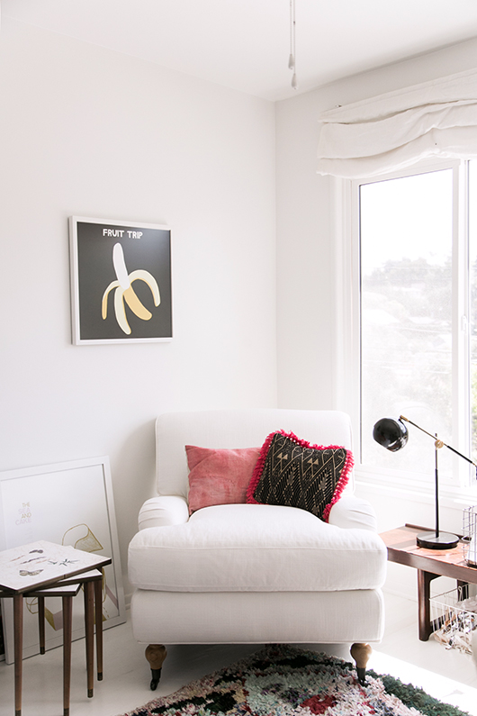 framed banana print and white home office chair / sfgirlbybay