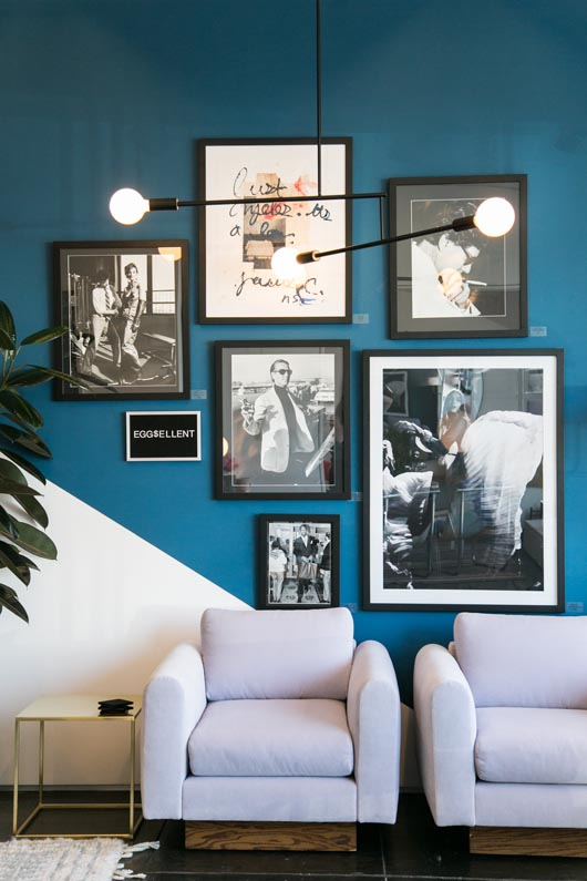 blue gallery wall and modern light fixture at Consort store in L.A. / sfgirlbybay