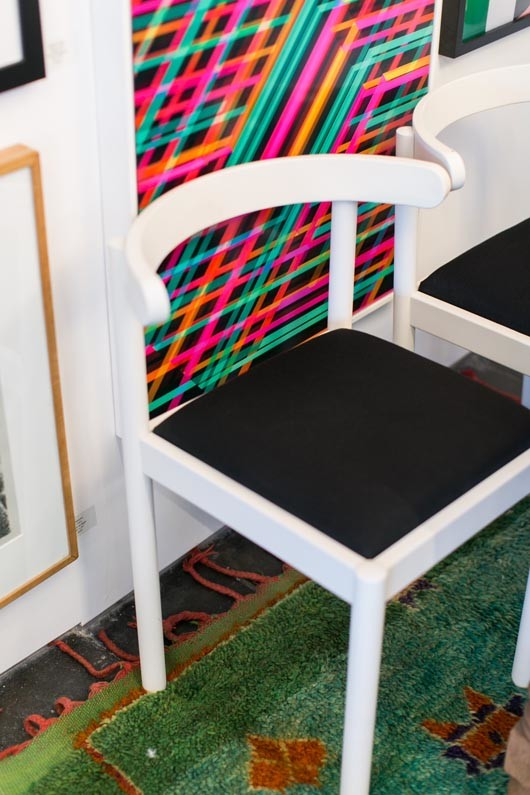 colorful framed artwork and black and white chairs at consort in l.a. / sfgirlbybay