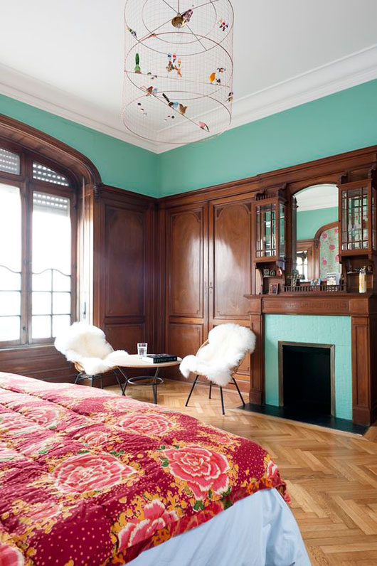 paris penthouse bedroom with teal walls, dark wood and birdcage light fixture. / sfgirlbybay