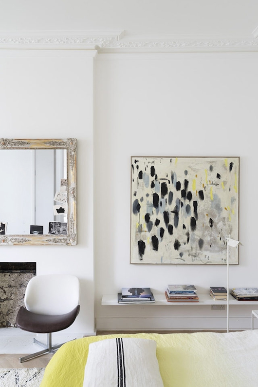 vintage mirror and modern chair in bedroom / sfgirlbybay