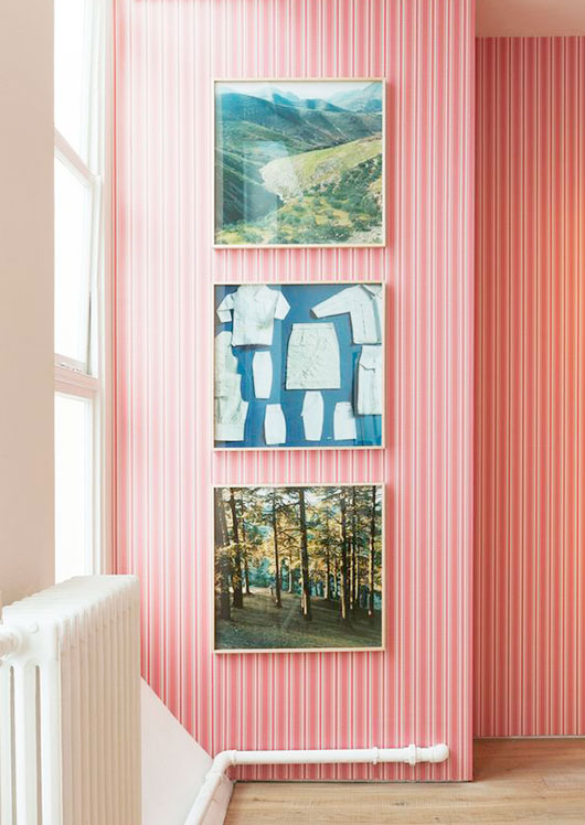 pink and white striped wallpaper with green landscape framed photography / sfgirlbybay