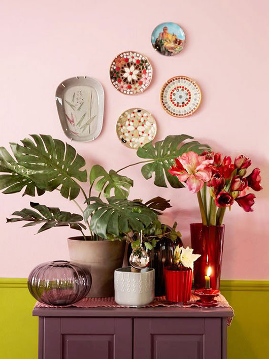 chartreuse and pink wall with plants and hung plates via ikea / sfgirlbybay