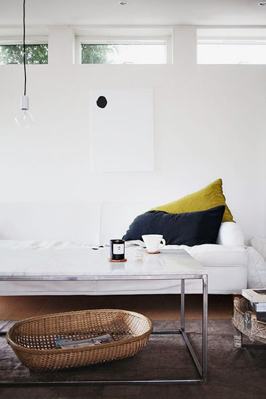low white sofa via the urbanite / sfgirlbybay