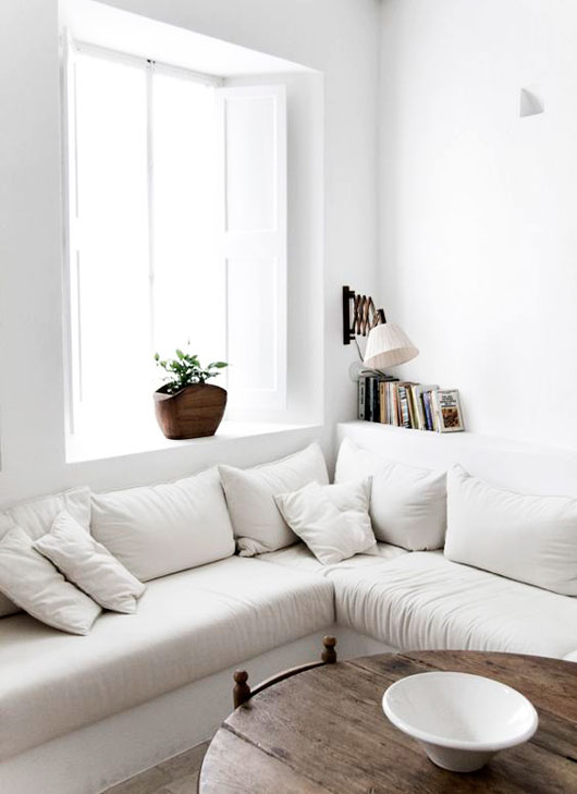 white sectional sofa in white living room / sfgirlbybay