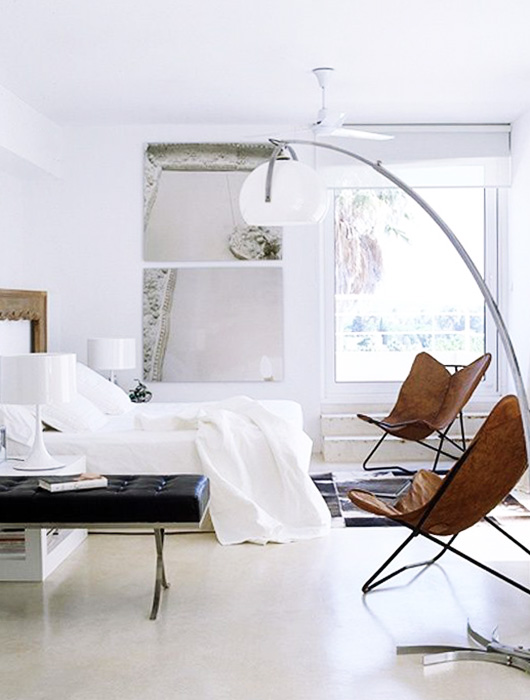 a pair of tan leather butterfly chairs in bedroom via muud magazine. / sfgirlbybay