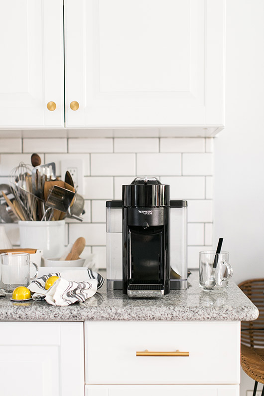 blck Nespresso coffee maker in modern white kitchen / sfgirlbybay