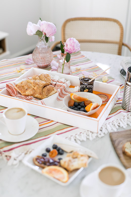 breakfast spread of foods and coffee and peonies in pink glass jars / sfgirlbybay