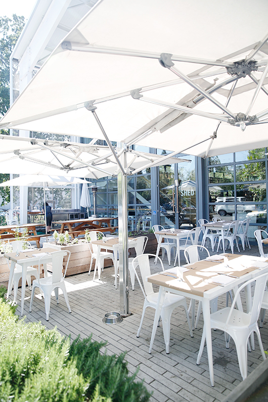 outdoor dining patio with white umbrellas at healdsburg shed / sfgirlbybay