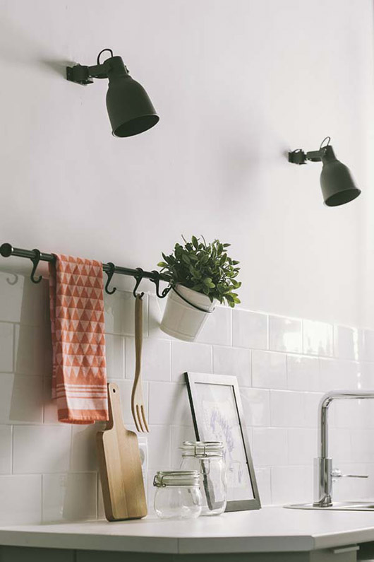 pink and red triangle print kitchen linen in modern white kitchen with industrial lights / sfgirlbybay