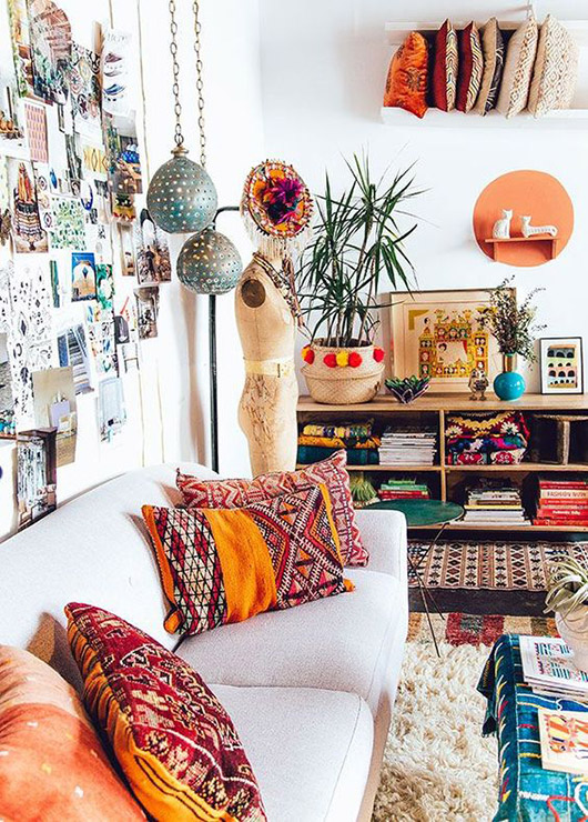 bohemian room with neutral sofa colorful accent textiles and decor / sfgirlbybay