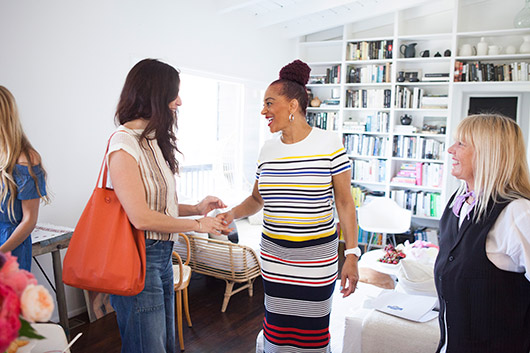 author terry mcmillan greets guests at the brunch I threw to celebrate her new book / sfgirlbybay