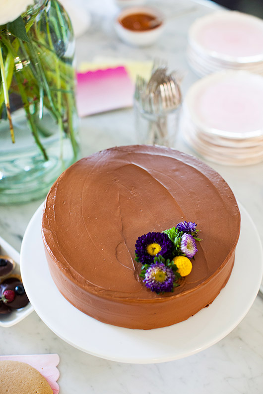 chocolate cake with chocolate frosting topped with purple and yellow flowers / sfgirlbybay