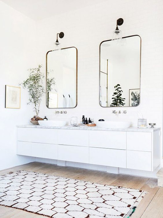 designer vanessa alexander's white and black malibu bathroom with matching mirrors and moroccan rug via my domaine. / sfgirlbybay