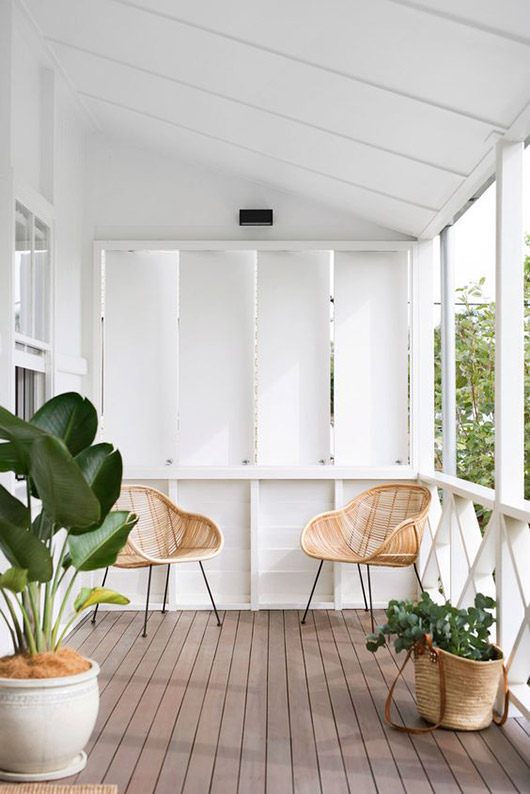 indoor outdoor whit room with matching rattan chairs / sfgirlbybay