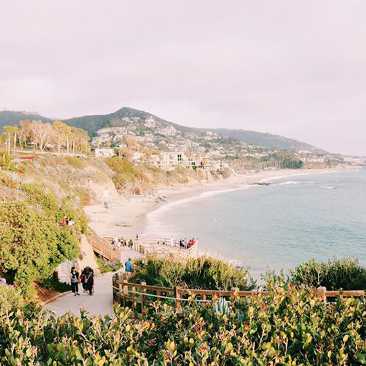 hazy pink sky above laguna beach in california / sfgirlbybay