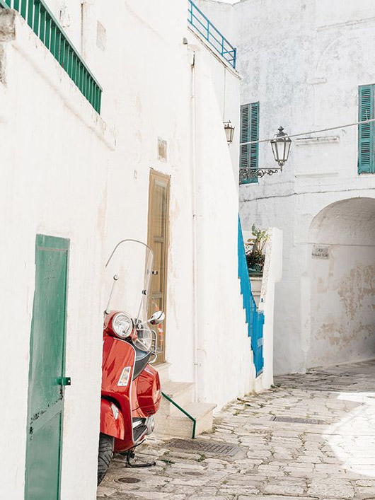 italian stone street with red scooter / sfgirlbybay