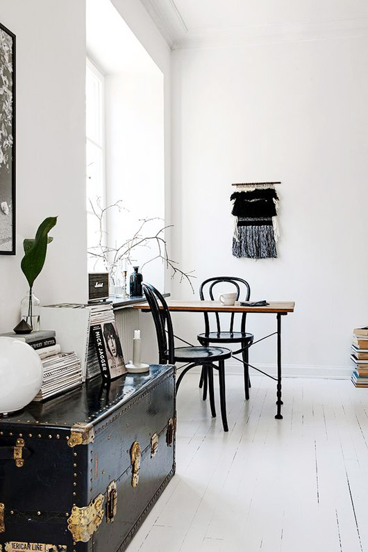 black and white living room with storage trunk as table / sfgirlbybay