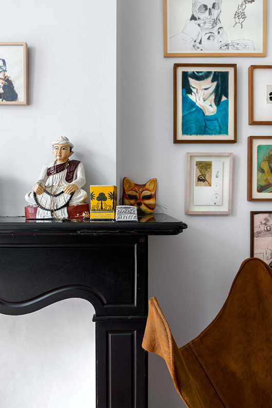 art gallery wall and mantle decor in artist's amsterdam home via vtwonen. / sfgirlbybay