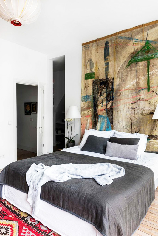 colorful art on canvas behind bed in artist's amsterdam home via vtwonen. / sfgirlbybay