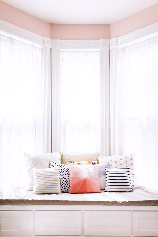 pink nook with colorful throw pillows / sfgirlbybay