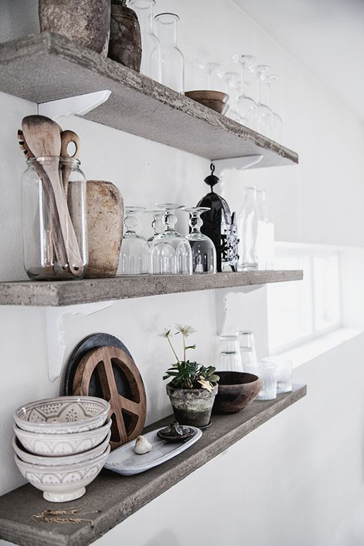 white walls with concrete shelves for kitchen storage / sfgirlbybay