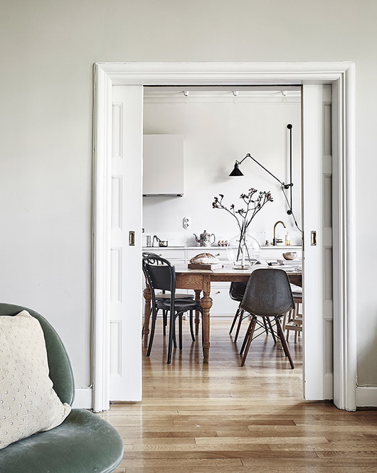 white walls and picket doors to dining room and kitchen. / sfgirlbybay