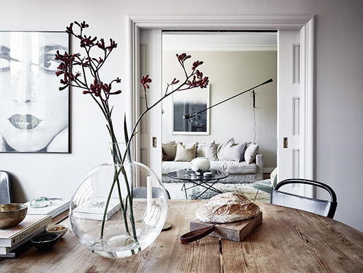 large glass vase on dining table in modern home. / sfgirlbybay