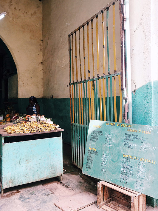 food stand and colorful gate in cuba. / sfgirlbybay