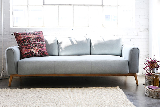 blue gray sofa from furniture maison with bohemian modern pillow / sfgirlbybay