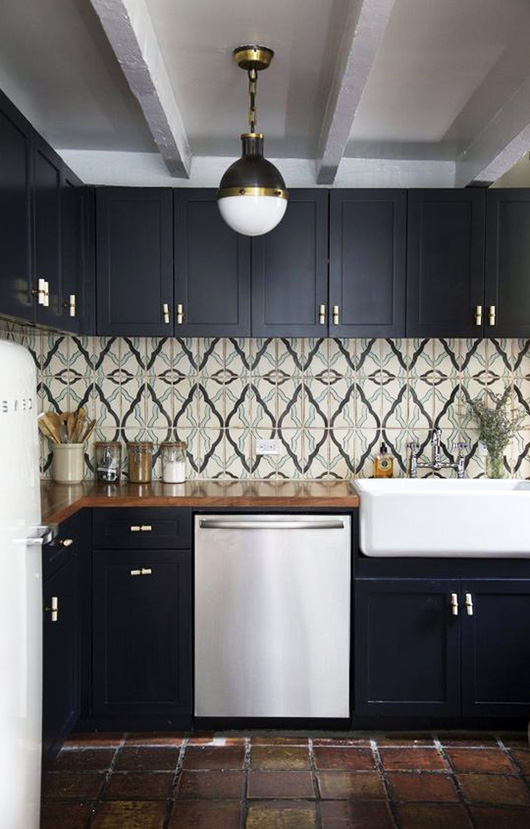 black kitchen cabinetry with white appliances and tile backsplash / sfgirlbybay