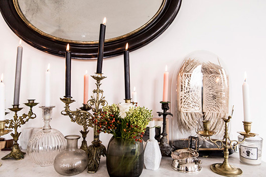 mantle with vintage glassware and candlesticks via milk decoration. / sfgirlbybay