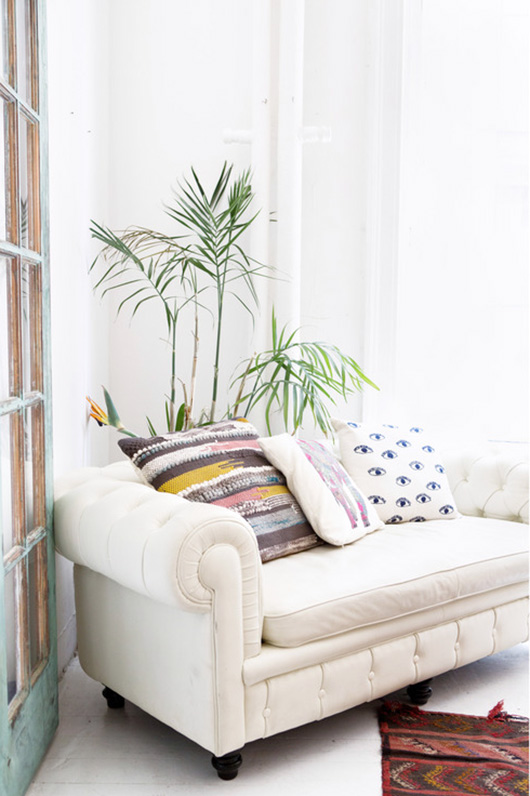 white sofa with colorful throw pillows photographed by sarah e. elliott. / sfgirlbybay