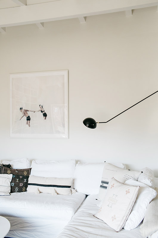 white linen sofa with throw pillows and oversized art. / sfgirlbybay