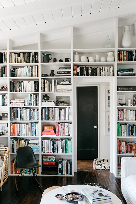 white built-in bookcases. / sfgirlbybay