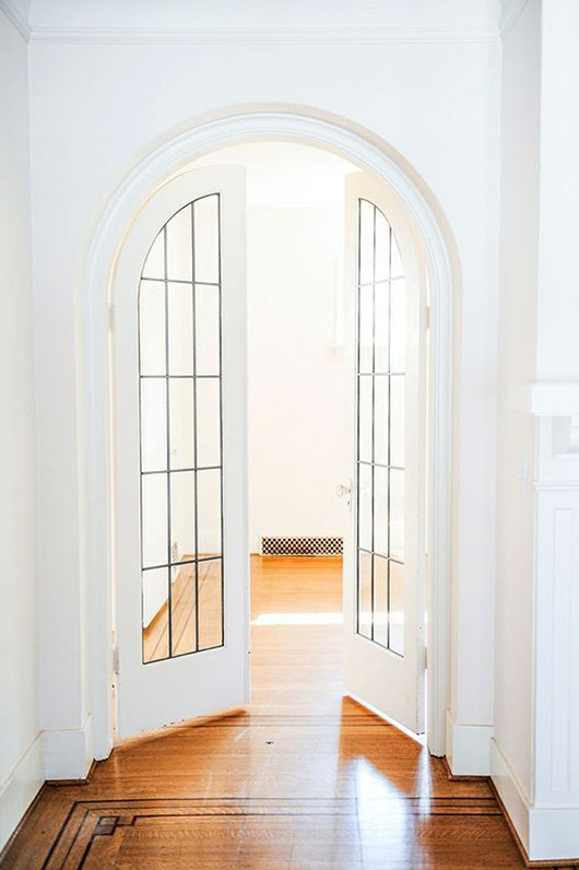 arched double doors with glass windows. / sfgirlbybay